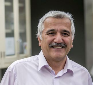 Photo of Hakan Ozdener, MD, PhD, MPH